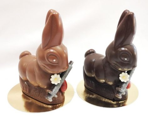 A Hungarian confectioner made chocolate bunnies holding vaccines for Easter